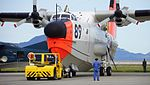 JMSDF US-1A(9089) towed by 5t class tractor(MC-0514) at Iwakuni Air Base September 14, 2014 04.jpg