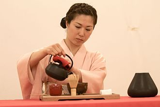 Tea culture - A Japanese woman performs a tea ceremony