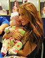 Jessie James holding a baby.jpg