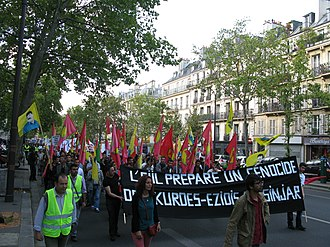 "Genocide of Yazidis by ISIL - Demonstration in Paris against persecution of Kurds and Yazidis, the sign reading ""ISIL is preparing a genocide against Yazidi Kurds""."
