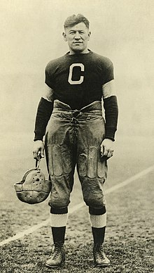 A black-and-white photograph of Jim Thorpe in his Canton Bulldogs football jersey.