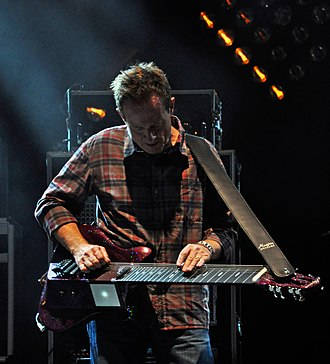 John Paul Jones (musician) - Jones playing a lap steel on stage