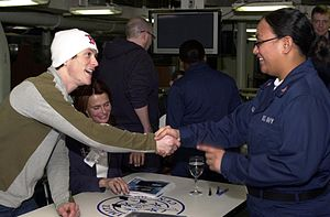 Jonathan Tucker - Tucker (left) and Serena Scott Thomas on the aircraft carrier USS Nimitz greeting sailors to promote the film Hostage in March 2005