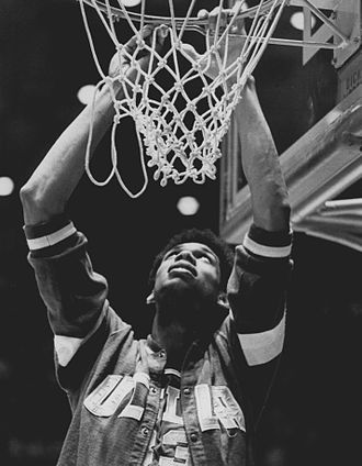 Kareem Abdul-Jabbar - Alcindor performing ceremonial net cutting at Freedom Hall in Louisville in 1969 after lopsided win over Purdue in unprecedented third-straight national title