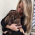 Karen Soeters with puppies in Curaçao.jpg