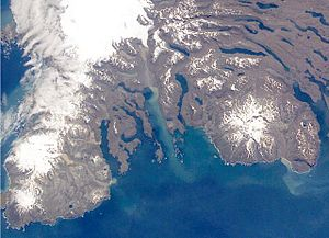 Baie Larose - Satellite image of the two large peninsulas of Rallier du Baty (left) and Gallieni (right) with Baie Larose immediately to the left of the latter