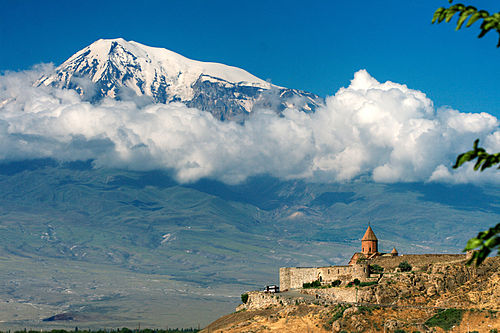 The 7th-century Khor Virap monastery in the shadow of Mount Ararat; Armenia was the first state to adopt Christianity as the state religion, in AD 301.[88]