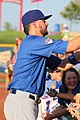 Kris Bryant signing autographs during his rehab assignment against Omaha (44315213571).jpg