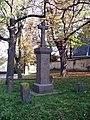 Kyje, kříž před kostelem sv. Bartoloměje.jpg