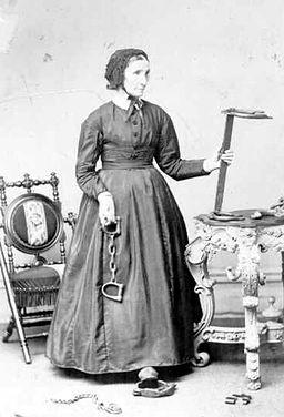 Laura Haviland holding slave irons ca. 1864