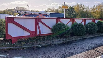 Fragments of the Archibald Leitch lattice work from the Main Stand now form part of the car park at the Stadium of Light. Leitch lattice work stadium of light.jpg