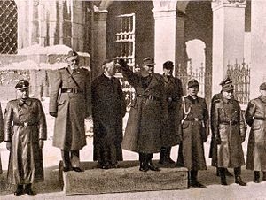 Gregorij Rožman - Leon Rupnik, Bishop Rožman and SS-General Erwin Rösener review Home Guard troops in front of Ursuline Church, Ljubljana, after the second Home Guard oath of allegiance, on 30 January 1945.