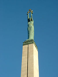 The statue of Liberty on top of the monument