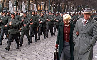 Max Manus: Man of War - Extras in German uniforms marching through the streets of Oslo during the filming of Max Manus