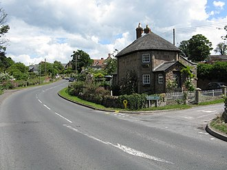 Lugwardine - The A438 road entering the western end of the village, with Tidnor Lane to the right.