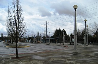Willow Creek/Southwest 185th Avenue Transit Center - Bus area with platform in the background