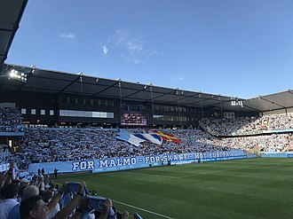 Tifo before a Champions League qualifier in 2018. The red and yellow flag is the Scanian flag. MFF-Vidi FC Champions League 2018-2019 Q3 Tifo.jpg