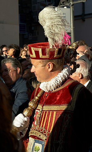 Mace-bearer - Spanish macero bearing a tabard with the coat of arms of the city of Madrid.