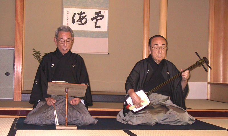 File:Man playing shamisen.jpg