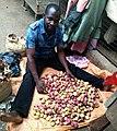 Man sorting kola nuts in the market.jpg