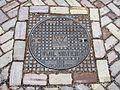 Manhole cover in Zeeuws Vlaanderen inscribed VUIL WATER which implies drains.JPG