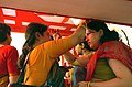 Married women exchanging vermilion, a ritual performed on the last day of the Durga Puja Celebrations, at a pandal in New Delhi on October 12, 2005.jpg