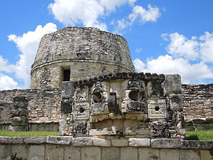 Mayapan - The Temple Redondo with a Mayan carving in the foreground.