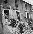 Members of a heavy rescue party evacuate civilians from a bomb damaged building during a large-scale Civil Defence training exercise in Fulham during 1942. D7905.jpg