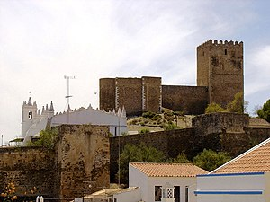 Castle of Mertola - A view of the castle as situated on the hilltop, with the mosque/Christian church