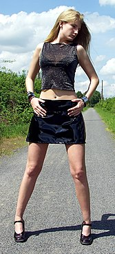 a woman modeling a miniskirt in the early 2000s