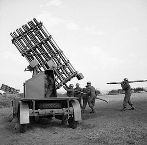 Z Battery - Royal Artillerymen load a mobile multiple launcher, June 1941
