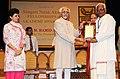 Mohd. Hamid Ansari presenting the Sangeet Natak Akademi Award-2010 to Shri Kalamandalam Kombil Gopalan Vasudevan Nair, Kerala, for his outstanding contribution to Kathakali.jpg