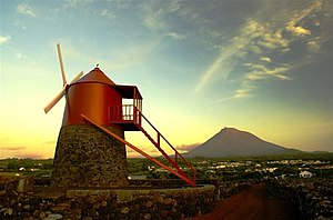 Pico Island - A traditional windmill along the coast of Monte, in the municipality of Madalena