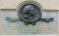 Memorial plaque dedicated to Wolfgang Amadeus Mozart in Václavské náměstí square in Olomouc (Czech Republic). Mozart in 1767 as an 11-year-old boy was fleeing from Vienna due to a smallpox epidemic and wrote his Sixth Symphony in F Major in Olomouc.