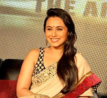 Rani Mukerji is smiling away from the camera