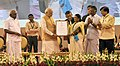 Narendra Modi gave away the Sant Kabir awards to the weavers for outstanding contributions, at the launch of the India Handloom brand, on the occasion of the National Handloom Day, in Chennai.jpg