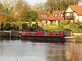 Narrowboat on the river - geograph.org.uk - 1593939.jpg
