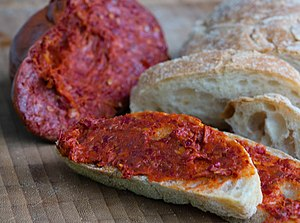 'Nduja - 'Nduja with bread, piece of sausage in background