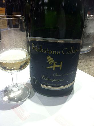 "Wine label - Sparkling wine from New York with a semi-generic usage of ""Brut American champagne."""