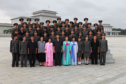 North Koreans posing for a photo in front of Kumsusan Palace of the Sun North Korea - Kumsusan (5015230319).jpg