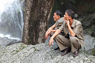 Vinylon - North Korean men wearing uniforms made from vinylon.