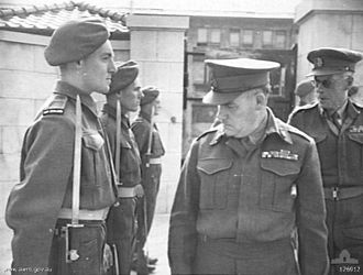 John Northcott - Northcott, as Commander In Chief, British Commonwealth Occupation Force (BCOF), inspects the guard of honour at HQ 9th New Zealand Infantry Brigade in Japan.
