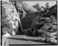OVERALL VIEW OF HIGHWAY THROUGH ROCK CUT, LOOKING EAST - Zion-Mount Carmel Highway, Springdale, Washington County, UT HAER UTAH,27-SPDA.V,3-2.tif