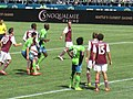 Obafemi Martins, guarded by Klute and Mari (14047482083).jpg
