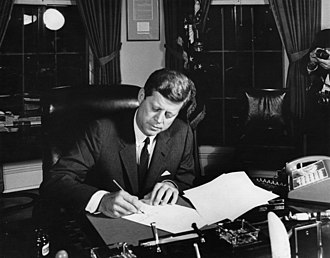 Kennedy Doctrine - President John F. Kennedy signing Proclamation 3504, authorizing the naval quarantine of Communist Cuba