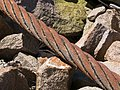 Old mooring steel wire rope and granite.jpg