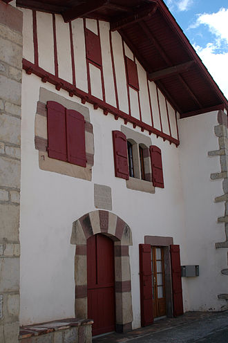 Baserri - An urban baserri with red-stained wood in Ortzaize. Note also the lack of a recessed portal.