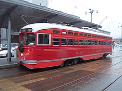 San Francisco Municipal Railway #1061, a rebuilt PCC streetcar painted in honor of the Pacific Electric Railway, is seen in service on the F Market heritage line in December, 2004. This single-ended car was originally built for the City of Philadelphia in 1946 (Pacific Electric only operated double-ended PCC's).