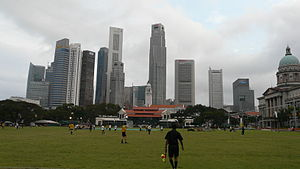 Padang, Singapore - A soccer match at the Padang set against the Singapore skyline