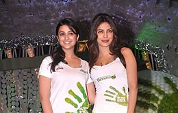 Parineeti and Priyanka Chopra are looking towards the camera.